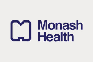 Dark blue monochromatic Monash Health logo correctly appears on a light grey background.
